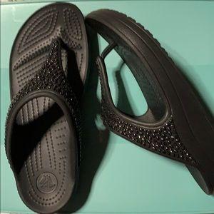 Crocs black flip flops